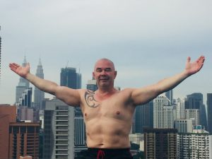 me at the infinity pool with the Petronas in the back